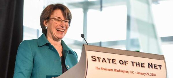 Amy Klobuchar giving the keynote address at the 2018 State of the Net Conference.
