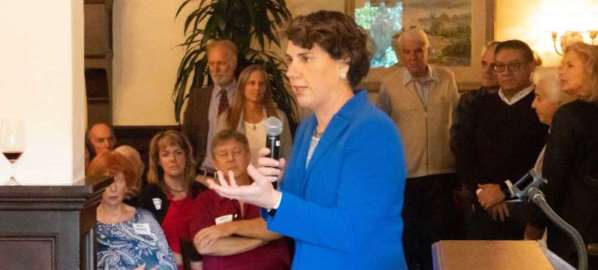 Amy McGrath speaking to supporters at a campaign event.