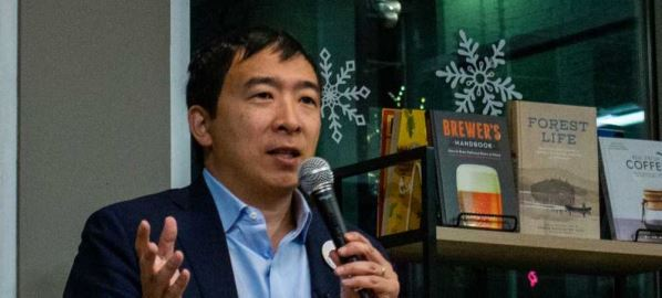 Andrew Yang speaking at a bookstore in Manchester, New Hampshire.