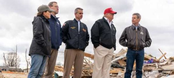 TN Gov. Bill Lee (far right) at a Cookeville neighborhood damaged by a tornado.