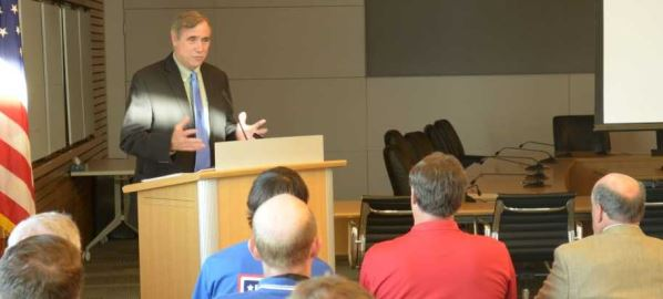 Jeff Merkley speaks to a gathering at a USO event, held August 21, 2012.