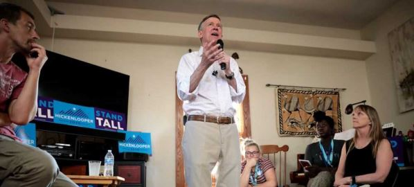 John Hickenlooper speaking with supporters at a house party in Des Moines, Iowa.