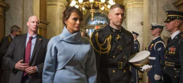 Melania Trump, escorted by a U.S. Marine at Donald Trump's inauguration.