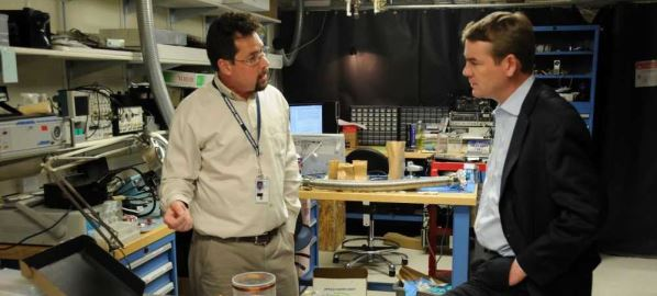 Michael Bennet speaking with Dr. John Kitching at the NIST in Boulder, CO.