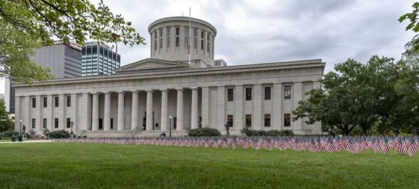 Ohio State Capitol with 2,977 American flags placed in front to honor 9/11 victims.