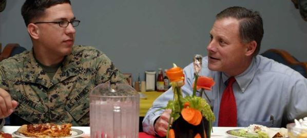 Senator, Richard Burr attending a lunch gathering with Cpl. Henry Sowell. 02/23/2006.