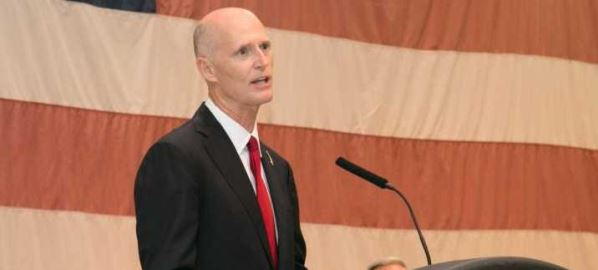 Rick Scott speaking at a  Florida Veterans Award Ceremony.