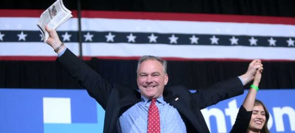 U.S. Senator Tim Kaine and Clarissa Felix speaking with supporters at a campaign rally.