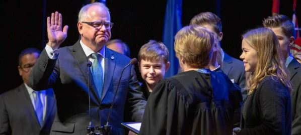 Tim Walz is sworn in as Minnesota's 41st governor at the Fitzgeral Theater in St Paul, MN.